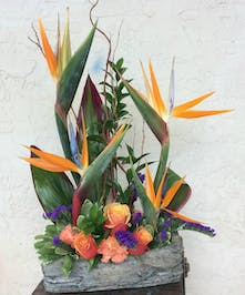 Tropical arrangement in keepsake ceramic log