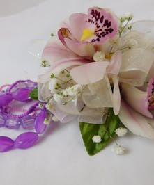 Dazzling cymbidium orchid wrist corsage for prom or homecoming