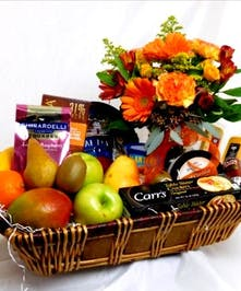 Fruit & Gourmet Basket with Flowers in Port Charlotte FL, Port Charlotte Florist