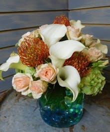 The Oceano - cala lilies, hydrangeas, protea, sweetheart roses, and greenery.