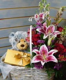 Gift and Flower Bundle - Fresh flowers, teddy bear and chocolates in a handled basket