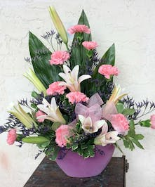 Pink and purple flowers in one sided modern arrangement
