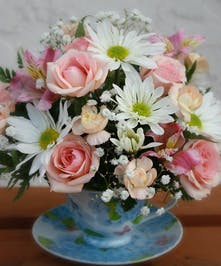 Tea Time - mix of spray roses, daisies and lillies in a keepsake Tea Cup