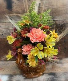 Adorable ceramic keepsake turkey packed with longlasting fall flowers | Port Charlotte Florist's best florist