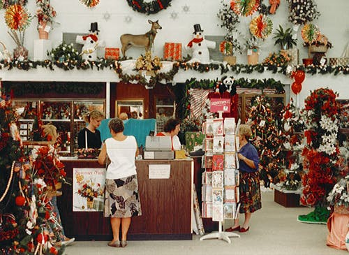 Christmas decorations abound in this early '90s holiday snapshot of the showroom floor